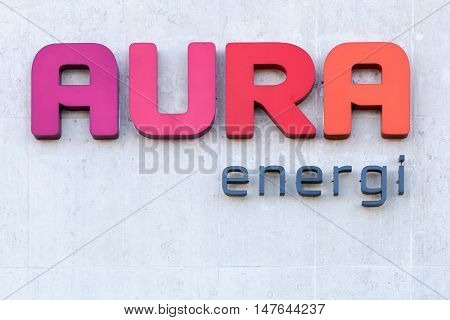 Viby, Denmark - September 11, 2016: Aura Energi logo on a wall. Aura Energi provides electricity, energy, fiber, televisions and home appliances in Denmark