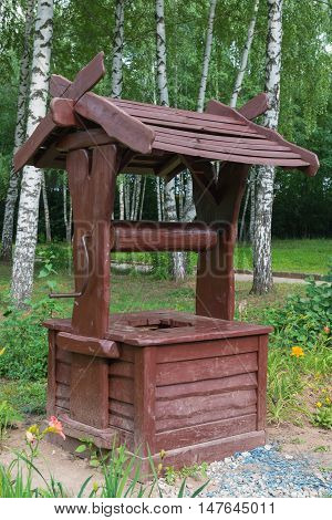dirty broun wooden well in the park
