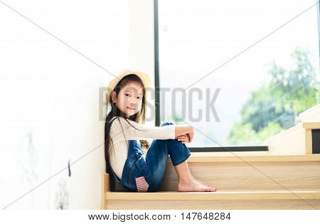 Young Girl Wating On The Step