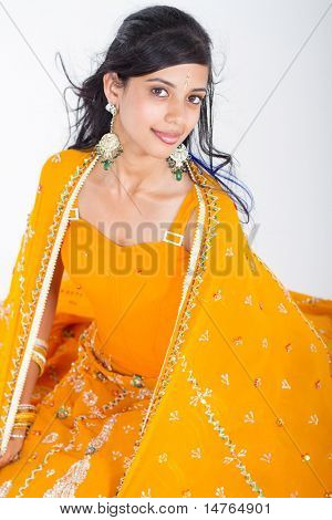 young indian woman in saree studio portrait