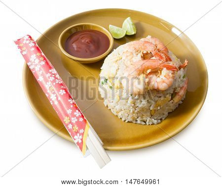 Food and Cuisine A Plate of Oriental Food Shrimp Fried Rice Served with Tomato Sauce and Lime Slice Isolated on White Background.