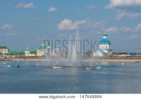 August 7 2016: Photo of Cheboksary bay with a fountain. People ride on boats and catamarans. Cheboksary. Russia.