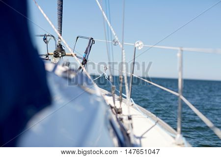 vacation, travel, cruise and yachting concept - close up of sailboat or sailing yacht deck and sea
