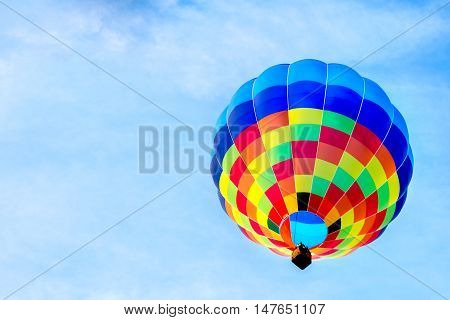 sinlge hot air balloon colorful blue sky background fly