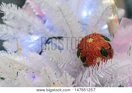 Christmas decorations on artificial fir. Christmas decorations on artificial fir. Christmas toy red ball with ornaments.