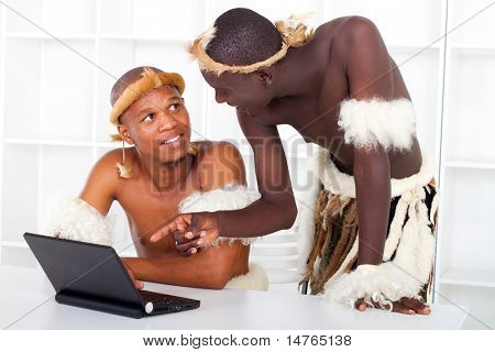 two african tribesman learning computer