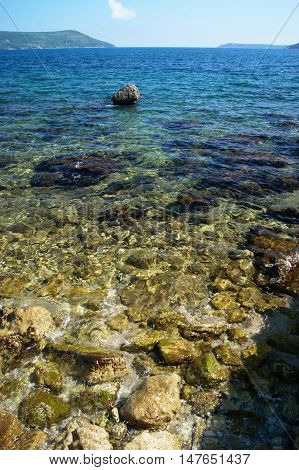 Pure clear water near the deserted beach in Boka Bay (Montenegro)
