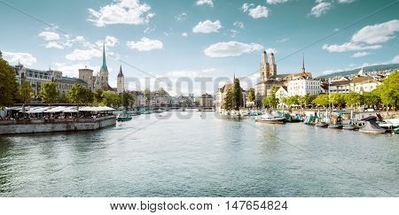 Panoramic view of historic Zurich city center with famous Fraumunster and Grossmunster Churches and river Limmat Switzerland
