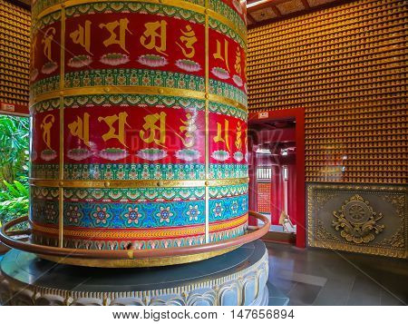 SINGAPORE, REPUBLIC OF SINGAPORE - JANUARY 09, 2014: Pavilion of the The Vairocana Buddha Prayer Wheel. Buddha Tooth Relic Temple, Chinatown, Singapore city