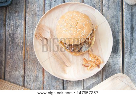 Homemade hamburger pork hamburger on wood plate
