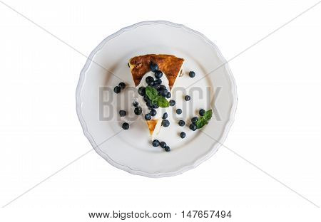 Cottage cheese baked pudding sour cream and blueberries in a rustic style