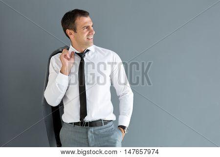 Man in shirt look aside with jacket over shoulder