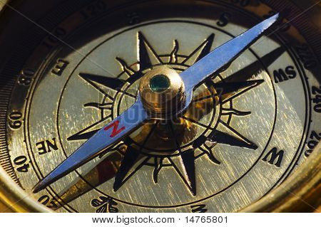 Old style gold compass closeup
