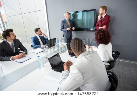 Manager and young employer discus about business in  company