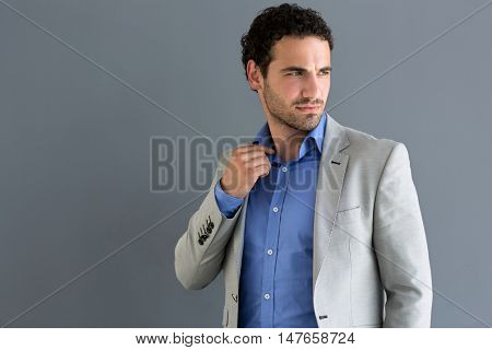 Young nervous businessman in suite