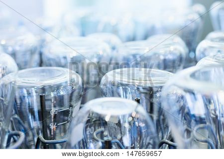 Flasks and test tubes installed in the tray of industrial dishwasher mashiny. Industrial background. shallow depth of field.