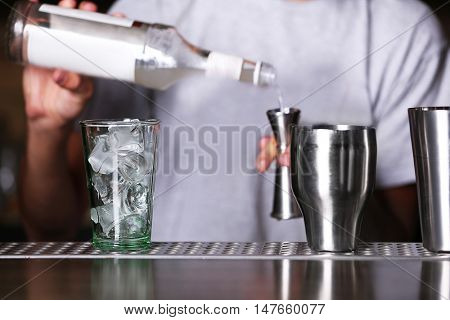 Barman preparing cocktail on bar counter