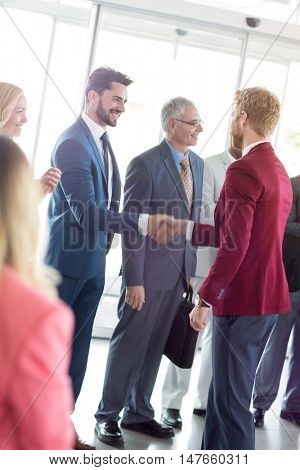 smiling business partners handshaking with leader in the sign of successful dealing