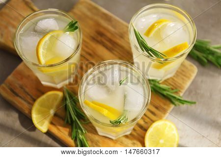 Cold fresh cocktails with lemon on cutting board