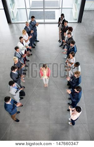smiling business partners applauding to happy confident leader
