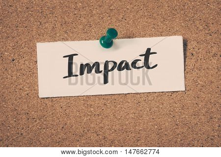 Impact note pin on the bulletin board