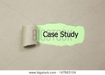 The text Case Study appearing behind torn paper.