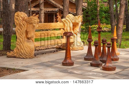 Large wooden Chess set in a city Park