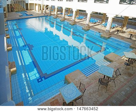 Swimming pool in the courtyard of a luxury hotel