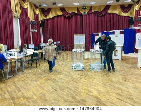 Moscow, Russia - September 18, 2016: The Voter Puts The Ballot In The Ballot Box In The Elections Of