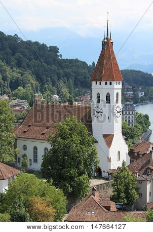 View of the picturesque Stadt Kirshce (Church) in Thun, a town in the Canton of Bern in Switzerland.