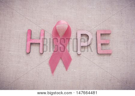 Pink Ribbons and HOPE word toning background Breast cancer awareness and Abdominal cancer awareness