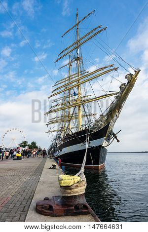 Sailing ship on the pier in Warnemuende Germany.