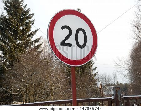 winter speed restriction of 20km/h road sign