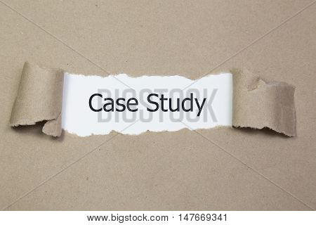 The text Case Study appearing behind torn brown paper