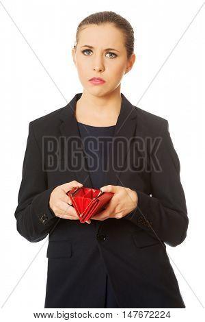 Upset businessswoman holding empty wallet