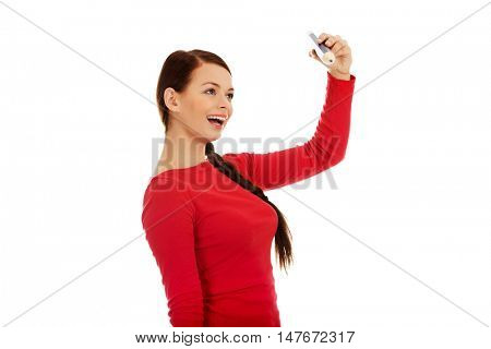 Beautiful young student woman with a big pencil