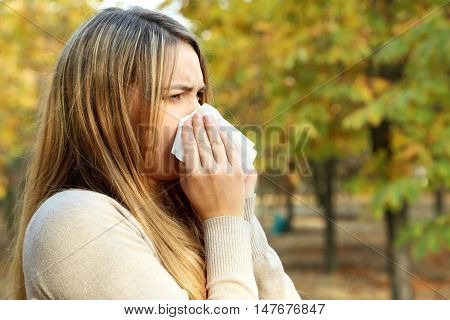 Young Girl With Allergy In Autumn Park