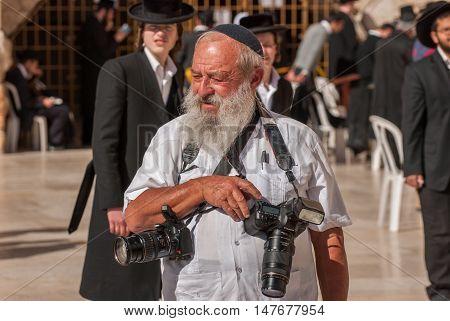 Orthodox Jewish Photographer Near The Western Wall .jerusalem. Israel