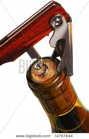 Opening a wine bottle with corkscrew, isolated on white