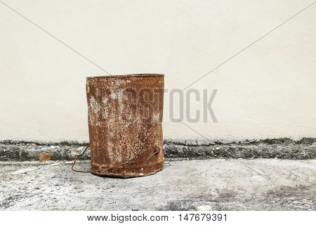 Rusty weathered tin can and space background