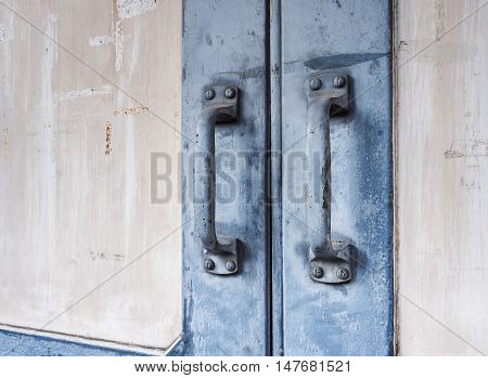 Blue steel door handles of the old wooden door, With place your text (door, handle, vintage)