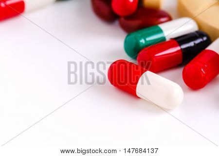 Many Pills And Pill Bottle Isolated On White Background