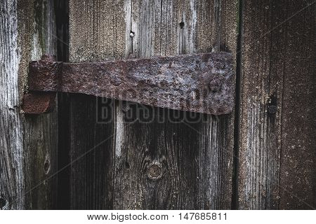 Old rusty hinge on a barn door