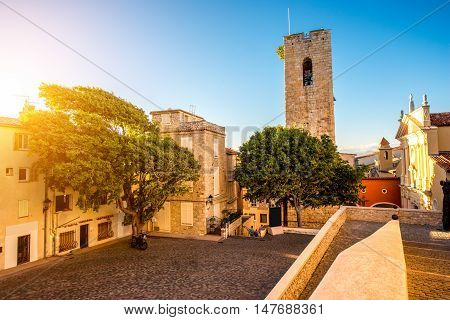 Central square with tower and church in Antibes coastal village on the french riviera in France