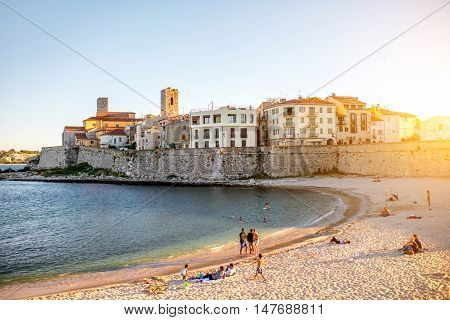 Antibes, France - June 14, 2016: Landscape view on the old coastal village and sandy beach with people in Antibes on the french riviera in France.