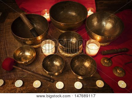 Studio shot of Tibetan singing bowls with burning candles