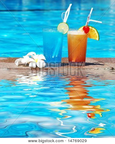Cocktails near the swimming pool with reflection