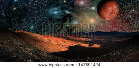 Fantastic landscape of another planet. Desert Night with stars and galaxies  (Elements of this image furnished by NASA)