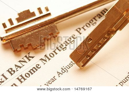 Mortgage application & keys. Shallow depth of field. Toned warm.