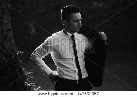 Man Puts On Suit Coat